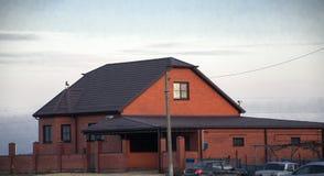 La maison du ` s de Zack est immeuble de brique, paysage de ciel Photographie stock libre de droits