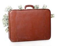 La maleta es llena de dinero Fotos de archivo
