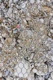 La malla de acero con la piedra gris Fotografía de archivo libre de regalías