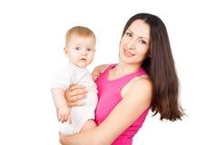 La mama guarda a un pequeño niño fotografía de archivo