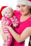 La mamma e la figlia del bambino di Santa celebrano il Natale Fotografia Stock