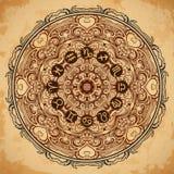 La mandala y el zodiaco adornados circundan con las muestras del horóscopo en fondo de papel envejecido Imagenes de archivo