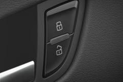 La maneta y el bloqueo de puerta de coche y abren Imagen de archivo libre de regalías