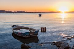 La Manga del Mar Menor at sunset. Abandoned boats and others for recreation and fishing in the Mar Menor, a saltwater lake Stock Images