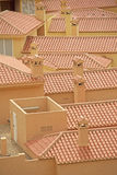 Clay Roof Tiles, Spain. This image shows the rooftops, roof tiles, chimneys and other features on some of the apartments, villas and buildings within the La royalty free stock images