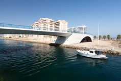 La Manga - SPAIN, AUGUST 25 2014: Drawbridge over water channel and Pleasure boat. At summer day Stock Photography