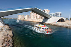 La Manga - SPAIN, AUGUST 25 2014: Drawbridge over water channel and Pleasure boat. At summer day Stock Photos