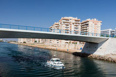 La Manga - SPAIN, AUGUST 25 2014: Drawbridge over water channel and Pleasure boat. At summer day Royalty Free Stock Photography