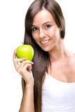 La manger-belle femme naturelle saine tient une pomme photographie stock