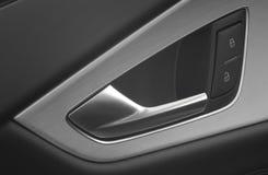 La maniglia e la serratura di portello dell'automobile e sbloccano Fotografia Stock Libera da Diritti