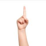 La mano aislada del niño muestra el número uno Imagen de archivo libre de regalías