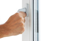 La mano apre una finestra Fotografie Stock