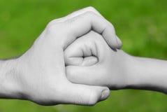 La mano cerca el puño Imágenes de archivo libres de regalías