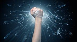 La mano colpisce intenso e rompe i vetri fotografia stock