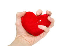 La mano comprime il cuore fotografie stock