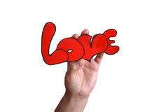 La mano con el ` del amor del ` de la palabra Imágenes de archivo libres de regalías