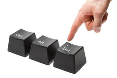 La mano con i colpi del dito indice spinge il tasto di cancellazione Fotografia Stock Libera da Diritti