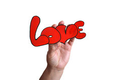 La mano con il ` di amore del ` di parola Immagini Stock Libere da Diritti