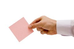 La mano con il foglio di carta Fotografie Stock Libere da Diritti