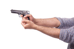 La mano con la arma de mano aislada en blanco Foto de archivo libre de regalías