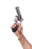 La mano con la arma de mano aislada en blanco Imagen de archivo