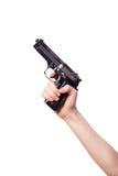 La mano con la arma de mano aislada en blanco Fotografía de archivo