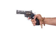 La mano con la arma de mano aislada en blanco Fotos de archivo libres de regalías