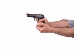 La mano con la arma de mano aislada en blanco Fotos de archivo