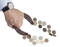 La mano con la herradura atrae el dinero Imagenes de archivo
