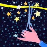 La mano con las tijeras corta la cinta amarilla Fotografía de archivo