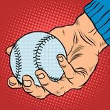 La mano con un baseball Immagine Stock