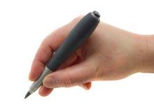La mano con una escritura de la pluma fotografía de archivo libre de regalías