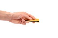 La mano dà la carta di credito Immagine Stock