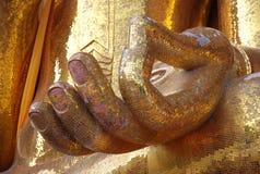 La mano de la imagen de Buda Foto de archivo