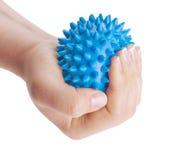 La mano de la mujer con la bola del masaje Foto de archivo libre de regalías