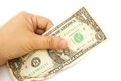 La mano de la mujer que lleva a cabo un un billete de dólar arrugado en el backgro blanco Fotografía de archivo