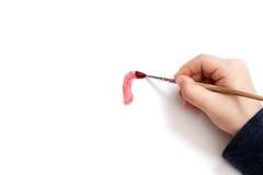 La mano del bambino comincia a disegnare Fotografie Stock Libere da Diritti