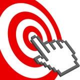 La mano del cursore indica per selezionare il bulls-eye rosso dell'obiettivo Immagine Stock