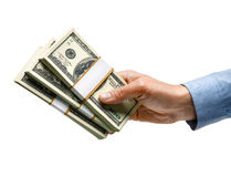 La mano del hombre de negocios está dando el dinero Fotos de archivo libres de regalías
