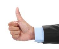 La mano del hombre de negocios que muestra los pulgares sube la muestra Imagenes de archivo