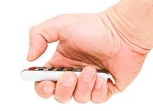 La mano del hombre del pulgar presiona el botón rojo. Imagen de archivo libre de regalías