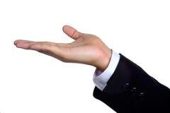 La mano del hombre firma adentro el traje aislado Imagen de archivo libre de regalías