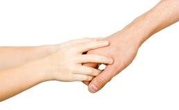 La mano del hombre que lleva a cabo la mano de un niño Imagenes de archivo