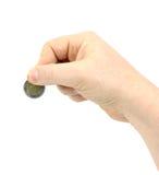 La mano del hombre, sosteniendo la moneda de 2 euros fotos de archivo libres de regalías