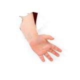 La mano del niño se pega hacia fuera del agujero Imagenes de archivo