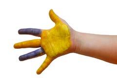 La mano del niño con la pintura Imagen de archivo libre de regalías