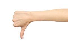 La mano del ` s de la mujer que muestra el pulgar abajo gesticula Foto de archivo libre de regalías
