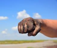 La mano del ` s dell'uomo fisted Fotografia Stock Libera da Diritti
