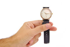 La mano dell'uomo con l'orologio elegante su un fondo bianco Cronometri il concetto Fotografie Stock Libere da Diritti