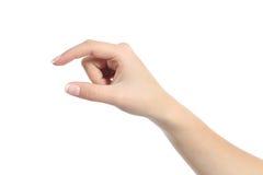 La mano della donna che tiene alcuno gradisce un oggetto in bianco Fotografie Stock Libere da Diritti